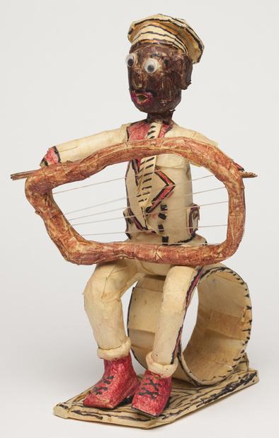 Willard hill   untitled %28man with harp sitting on circle%29   masking tape mixed media   10.5x7x6 in   good lu medium