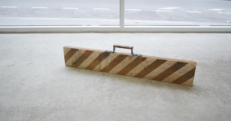Dominique Mathieu, La Limite, 2016—Pièce de bois recyclé, partiellement blanchie, poignée fer et bois, 105 x 24 x 4 cm, pièce unique